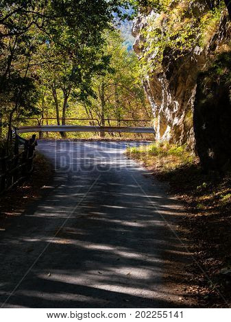 Mountain road crossing with old guardrail vintage