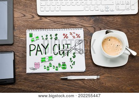 Salary Paycut Drawing In Notepad At Desk