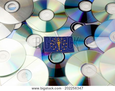 Indiana Flag On Top Of Cd And Dvd Pile Isolated On White