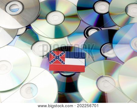Mississippi Flag On Top Of Cd And Dvd Pile Isolated On White