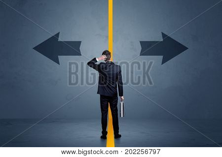 Business person choosing between two options separated by a yellow border arrow concept