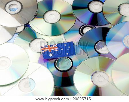 Australian Flag On Top Of Cd And Dvd Pile Isolated On White