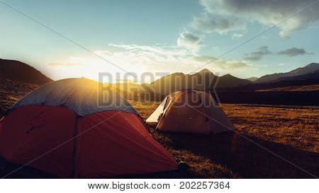 Tents During Beautiful Sunrise Near The Mount Elbrus In Russia
