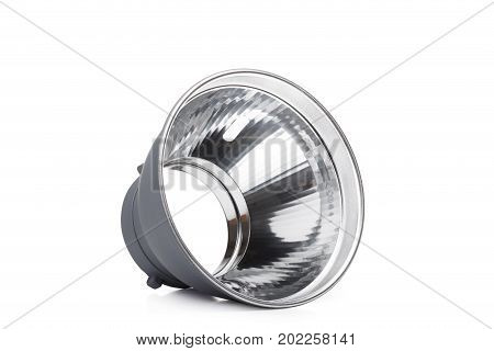 A part of a studio flash isolated on a white background. Photo-studio with lighting equipment. Modern photographic flash. Professional photo equipment. Studio photography video light.