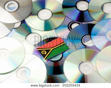 Vanuatu Flag On Top Of Cd And Dvd Pile Isolated On White