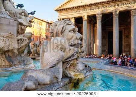Old fountain and the Pantheon  in central Rome illuminated at sunset