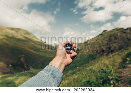 Man Explorer Searching Direction With Compass In Summer Mountains Point Of View Shot