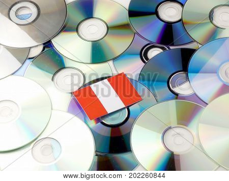 Peruvian Flag On Top Of Cd And Dvd Pile Isolated On White