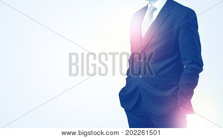 Young businessman standing and thinking without head