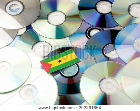 Sao Tome And Principe Flag On Top Of Cd And Dvd Pile Isolated On White