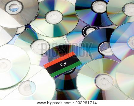 Libyan Flag On Top Of Cd And Dvd Pile Isolated On White