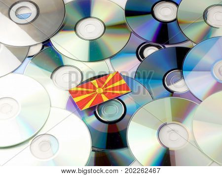 Macedonian Flag On Top Of Cd And Dvd Pile Isolated On White