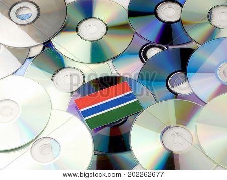 Gambia Flag On Top Of Cd And Dvd Pile Isolated On White