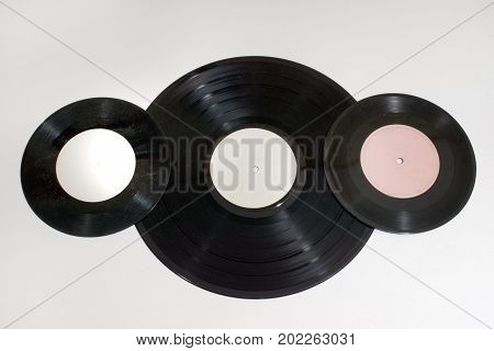 Vinyl records of a different disc diameters