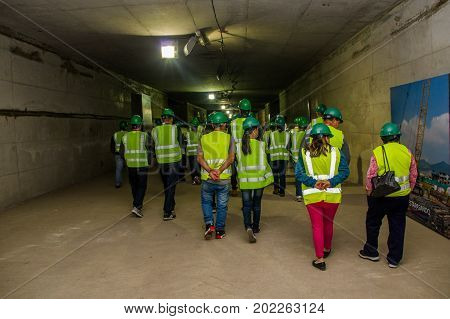 Quito, Pichincha Ecuador - August 27 2017: Unidentified people walking and checking the metro construction located inside of the Bicentenario park, at north part of the city of Quito.