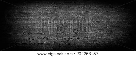 Black brick wall background. Wide high resolution panorama of brickwork