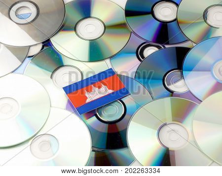 Cambodian Flag On Top Of Cd And Dvd Pile Isolated On White