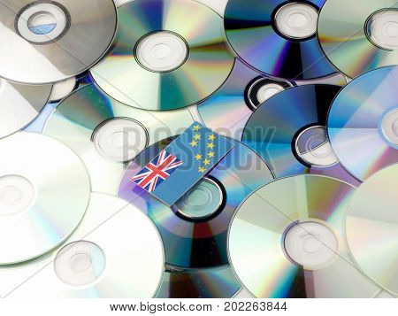 Tuvalu Flag On Top Of Cd And Dvd Pile Isolated On White