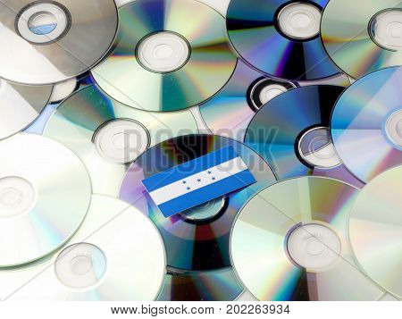 Honduras Flag On Top Of Cd And Dvd Pile Isolated On White