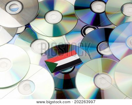 Sudan Flag On Top Of Cd And Dvd Pile Isolated On White