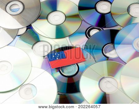 Samoa Flag On Top Of Cd And Dvd Pile Isolated On White
