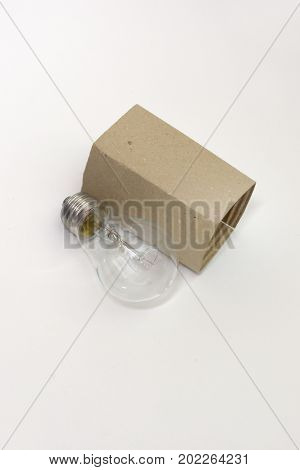 New Incandescent Bulb Next To The Cardboard Packaging For Storage
