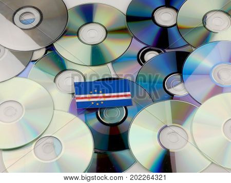Cape Verde Flag On Top Of Cd And Dvd Pile Isolated On White