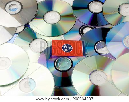 Tennessee Flag On Top Of Cd And Dvd Pile Isolated On White