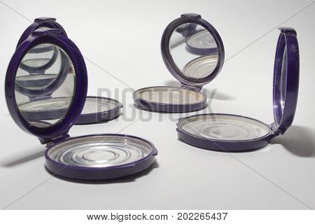 Empty Powder Case With Mirror, That Reflect Each Other