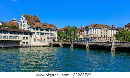 Zurich, Switzerland - 18 June, 2017: the Limmat river, city's old town buildings along it, Rudolf Brun bridge over the river. Zurich is the largest city in Switzerland and the capital of the Swiss canton of Zurich.
