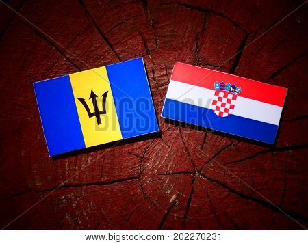 Barbados Flag With Croatian Flag On A Tree Stump Isolated