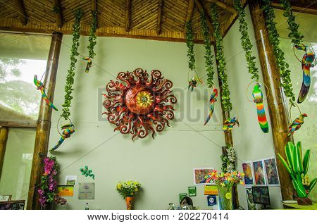 MINDO, ECUADOR - AUGUST 27, 2017: Beautiful handicrafts hanging from walls, located in Mindo recreation place, in western Ecuador, at 1, 400m elevation in Mindo, Pichincha.