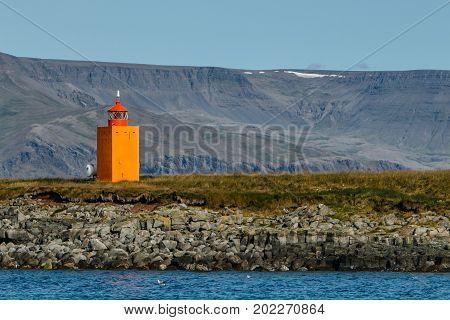 Waterway channel marker near Reykjavik port .