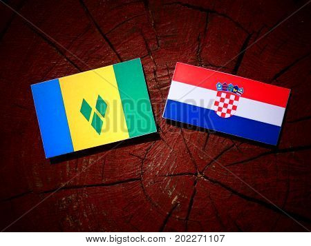 Saint Vincent And The Grenadines Flag With Croatian Flag On A Tree Stump Isolated