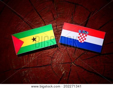 Sao Tome And Principe Flag With Croatian Flag On A Tree Stump Isolated