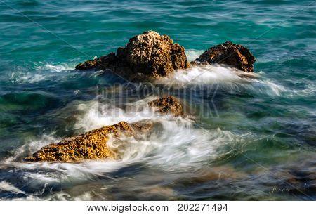 Waves crashing against rocks on sea in Opatija Croata