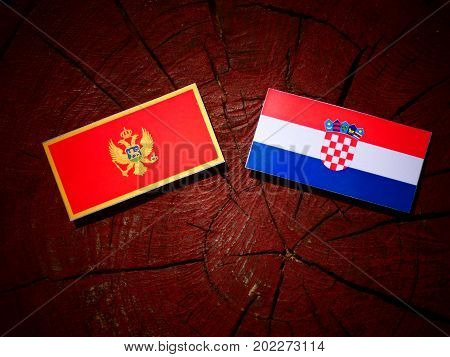 Montenegrin flag with Croatian flag on a tree stump isolated poster