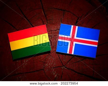 Bolivian Flag With Icelandic Flag On A Tree Stump Isolated