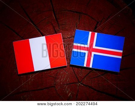 Peruvian Flag With Icelandic Flag On A Tree Stump Isolated