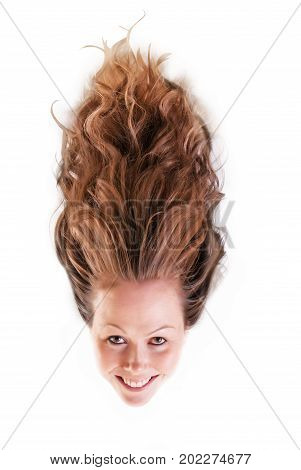 Spooky view of a pretty girl with her hair raising up above her head.