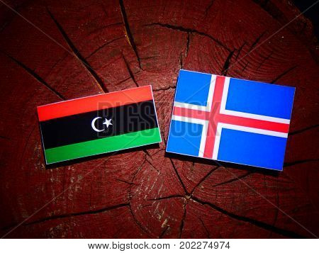 Libyan Flag With Icelandic Flag On A Tree Stump Isolated