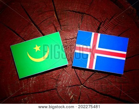 Mauritania Flag With Icelandic Flag On A Tree Stump Isolated