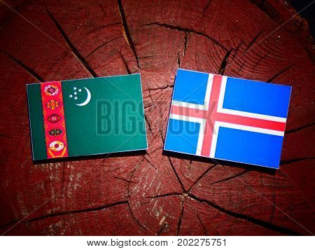 Turkmenistan Flag With Icelandic Flag On A Tree Stump Isolated