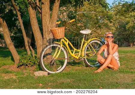 Beautiful Woman With Bike, In Park.