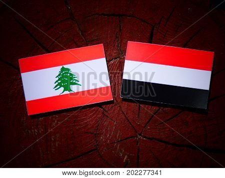Lebanese Flag With Yemeni Flag On A Tree Stump Isolated