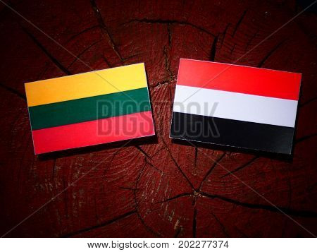 Lithuanian Flag With Yemeni Flag On A Tree Stump Isolated