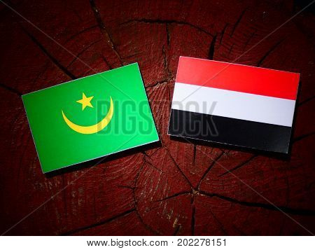 Mauritania Flag With Yemeni Flag On A Tree Stump Isolated