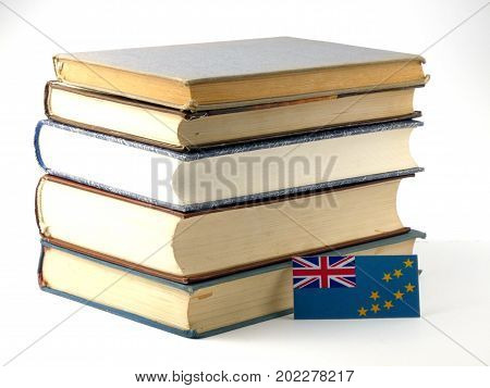 Tuvalu Flag With Pile Of Books Isolated On White Background