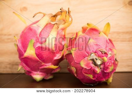 Dragon fruit or pitaya on wooden background, Tropical fruit