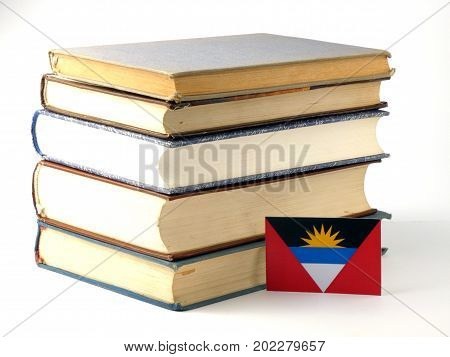 Antigua And Barbuda Flag With Pile Of Books Isolated On White Background